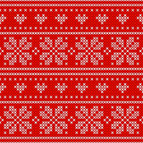 Red Holiday seamless pattern with cross stitch embroidered happy new year ornament heart and snowflake .