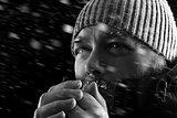 Man freezing in snow storm BW