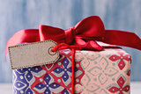 gift with red ribbon bow and blank label