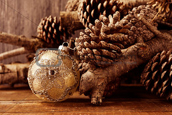 christmas ball, logs and pine cones