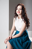 Colorful photo of a woman in white top and dark blue skirt