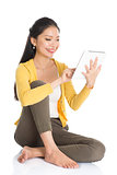Young Asian woman using tablet pc