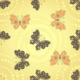 Seamless golden pattern with brown and beige butterflies