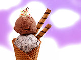 Chocolate and Cookie ice cream cone against white/purple background