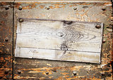 Old wooden board with cracked paint surface