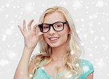 happy young woman or teenage girl in glasses