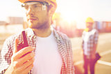 close up of builder in hardhat with walkie talkie