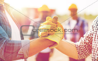 close up of builders hands making handshake