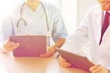 doctors with tablet pc and clipboard at hospital