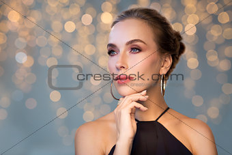 beautiful woman in black wearing diamond jewelry