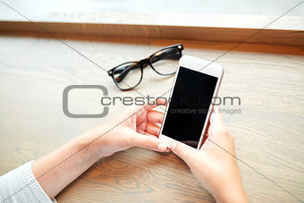 close up of woman texting on smartphone