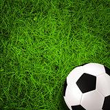 football, soccer ball on green grass field