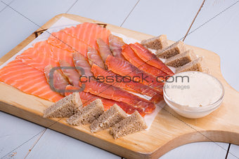 Sliced fish meat on wooden board