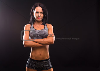 Fitness womna posing in studio