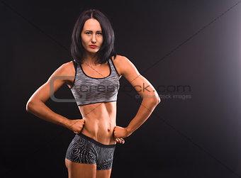 Fitness womna posing in studio
