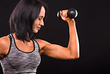 Fitness woman training with dumbbells