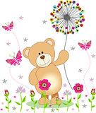 Teddy bear holding dandelion