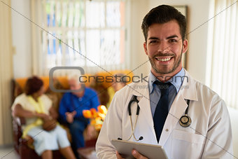 Portrait Of Happy Young Doctor Working In Medical Clinic