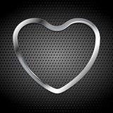 Metallic heart on perforated background