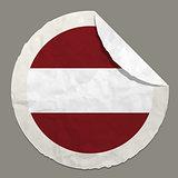 Latvia flag on a paper label
