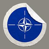 NATO flag on a paper label