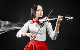 Attractiv ewoman playing the violin on a black background