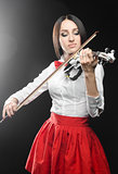 Beautiful woman playing the violin on a black background