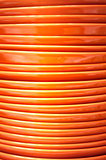Stack of orange plates close-up