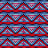Seamless knitted pattern with triangle ornament