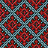 Seamless knitted pattern mainly in red and blue hues