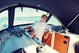 happy senior man on boat or yacht sailing in sea