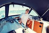happy senior man on boat or yacht sailing in sea