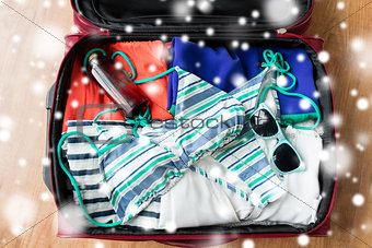close up of travel bag with beach clothes