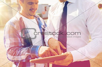 close up of builder and businessman with tablet pc