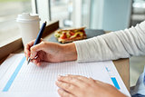 woman with paper form having lunch at cafe