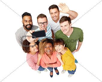 group of people taking selfie by smartphone
