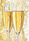 Two glasses of champagne on bokeh background