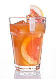 Glass of healthy grapefruit  juice with fruit