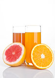Glasses of healthy grapefruit  and orange juice