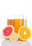 Glasses of healthy grapefruit and orange juice