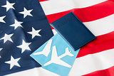 american flag, passport and air tickets