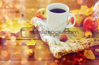 close up of tea cup on table with autumn leaves