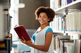 happy african student girl reading book at library