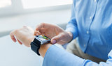 close up of hands with web page on smart watch