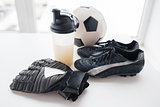 close up of football, boots, gloves and bottle