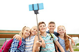 happy elementary school students taking selfie