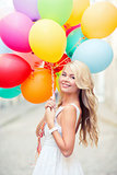 woman with colorful balloons