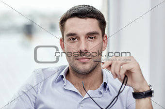 portrait of businessman with eyeglasses at office