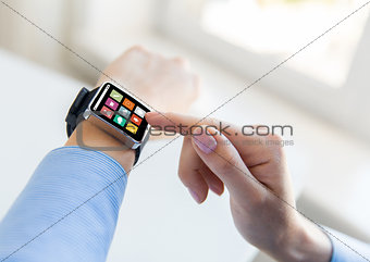 close up of hands setting smart watch with icons