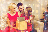 smiling family with tablet pc